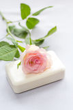 Beautiful, pink rose and a soap Stock Images