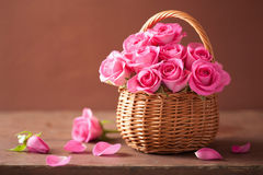 Beautiful pink roses in basket royalty free stock photo