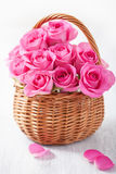 Beautiful pink roses in basket Stock Photo