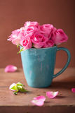 Beautiful pink roses bouquet in mug Royalty Free Stock Image