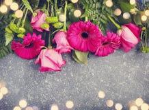 Beautiful pink roses and gerberas border with bokeh Stock Images