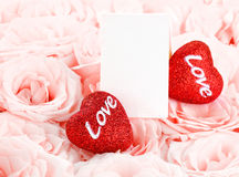 Beautiful pink roses with gift card & hearts Royalty Free Stock Photo