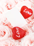 Beautiful pink roses with gift card & hearts Stock Photos