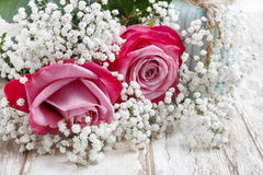 Beautiful pink roses and Gypsophila (Baby's-breath flowers).