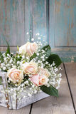 Beautiful pink roses and gypsophila paniculata (Baby's-breath fl