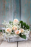Beautiful pink roses and gypsophila paniculata (Baby's-breath