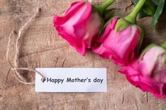 Pink roses with Happy Mother`s day tag card. Beautiful pink roses with Happy Mother`s day tag card, top view Royalty Free Stock Photo