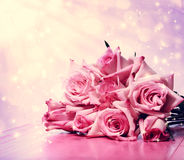 Beautiful pink roses on pink wooden table Royalty Free Stock Images