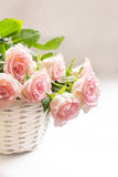 Beautiful, pink roses in a white basket close up. Beautiful, pink roses in a white wicker basket close up Royalty Free Stock Photos