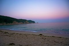 Beautiful pink sunset on the beach. the Sun sit down and leave the pink sky. The calm sea, calm Stock Images