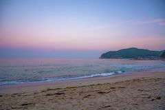 Beautiful pink sunset on the beach. the Sun sit down and leave the pink sky. The calm sea, calm Stock Photos