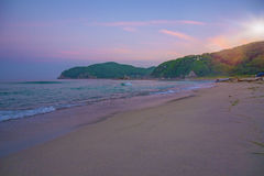 Beautiful pink sunset on the beach. the Sun sit down and leave the pink sky. The calm sea, calm Royalty Free Stock Photos
