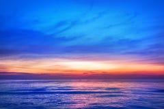 Beautiful pink sunset, blue sky, purple sea background, blurred watercolor sunrise, quiet ocean beach landscape, peaceful morning