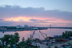 A beautiful pink sunset over the city River. Industrial landscape. stock images