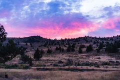 Beautiful pink sunset over the desert hills of Oregon royalty free stock image