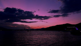 Beautiful pink sunset over the mountains in the background. Of the sea stock video