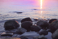 Beautiful pink sunset over a rocky coast Royalty Free Stock Images