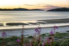 Beautiful pink sunset on the sea. Gorgeous northern nature. Horizontal royalty free stock image