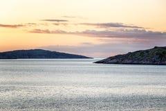 Beautiful pink sunset on the sea. Gorgeous northern nature. Horizontal royalty free stock photo