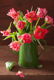 Beautiful pink tulip flowers bouquet in green pot Stock Images