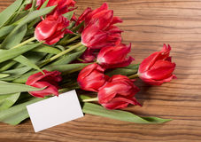 Beautiful pink tulips with white card Royalty Free Stock Photography