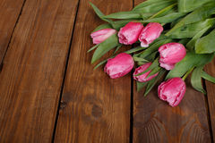 Beautiful pink tulips on wooden background Royalty Free Stock Photos