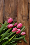 Beautiful pink tulips on wooden background Royalty Free Stock Image