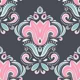 Beautiful pink and turquoise floral seamless pattern on a black background. Paisley elements. Ornament. Traditional, Ethnic, Turkish, Indian motifs. Great for Royalty Free Stock Image