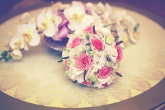 Beautiful pink wedding bouquet on the table Stock Photography