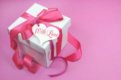Beautiful pink and white gift box present on pink background Royalty Free Stock Images