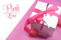 Beautiful pink and white gift box present with sample text on white Royalty Free Stock Images