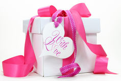 Beautiful pink and white gift box present on white background. Royalty Free Stock Photos