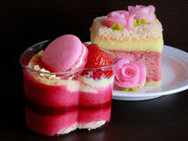 Beautiful pink yogurt cake decorate with macaron and strawberry. Beautiful pink yogurt cake on beautiful plate Royalty Free Stock Photography