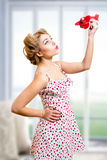 Beautiful pinup blond pretty lady playing with Royalty Free Stock Image