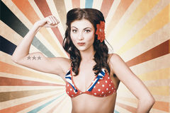 Beautiful pinup girl flexing muscle. womens rights Stock Images