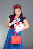 Beautiful pinup girl with presents Royalty Free Stock Photos