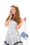 Beautiful pinup girl talking on phone, isolated Royalty Free Stock Photography
