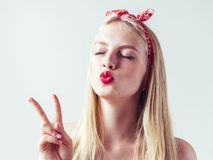 Beautiful pinup woman with long blonde hair natural on white bac. Kground. Studio shot stock photography
