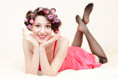 Beautiful pinup woman lying in bed Stock Image