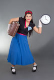 Beautiful pinup woman with retro suitcase and clock Royalty Free Stock Image