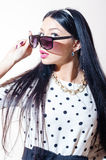 Beautiful pinup woman with sunglasses surprised Royalty Free Stock Photography