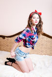 Beautiful pinup young woman girl with red lipstick looking at camera picture Royalty Free Stock Photo