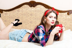 Beautiful pinup young woman girl with red lipstick looking at camera Stock Photos