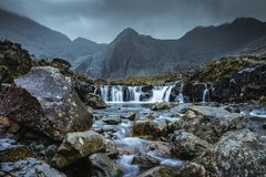 Fairy Pools at the Isle of Skye. This beautiful place you can find in Scotland. These are waterfalls with a beautiful mountain background royalty free stock photos