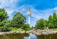 Beautiful Planten um Blomen park and famous Heinrich-Hertz-Turm, Hamburg, Germany. Beautiful view of flower garden in Planten um Blomen park with famous Heinrich Stock Photo