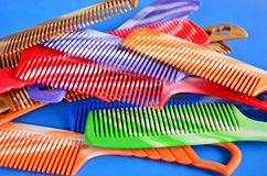 Beautiful plastic combs. Collection of plastic combs on blue background Stock Photo