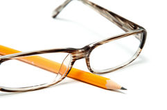 Beautiful Plastic Glasses And A Pencil Royalty Free Stock Image