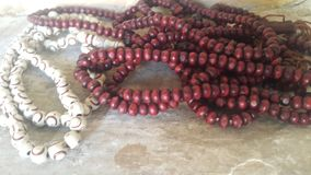 Beautiful plastic prayer beads or rosary placed over concrete background