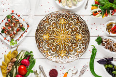 Beautiful plate in center of food, void, flat lay Stock Images