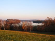 Plateliu lake, trees and beautiful sky, Lithuania stock photo